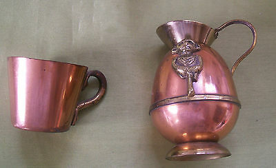 2 small copper and brass jugs