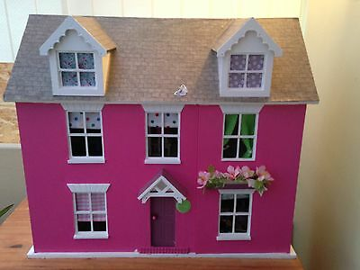 Dolls house with furniture.