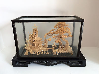 Chinese Cork Carving in display box.