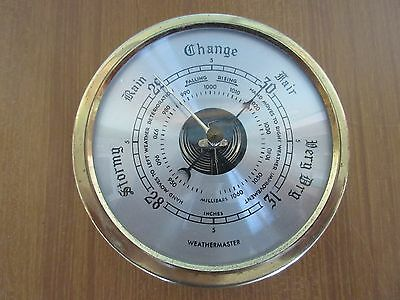 "Marine Brass cased barometer, 5 1/2"" diameter."