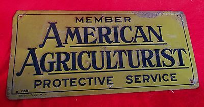 American Agriculturist Protective Service Embossed Tin Sign 1958 Bradco