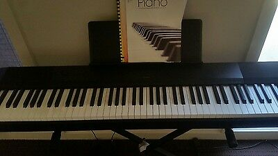 electric piano with stand (casio)