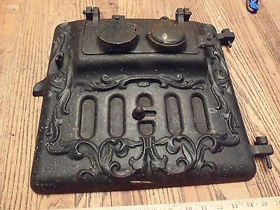 vintage cast iron ornate enbossed stove / furnace door