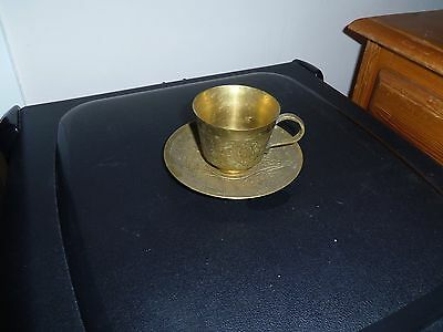 brass tea cup and saucer ( i think )