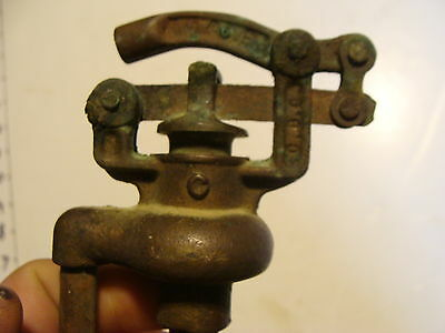 cool old pump item, copper and brass, toilet perhaps