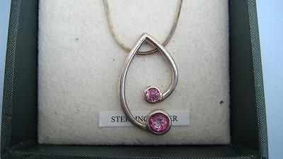 silver and pink stone pendant and earring studs