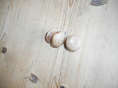 A pair of vintage wooden drawer handles.