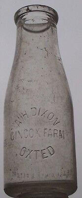 Pint wide-necked milk bottle from DIXON, OXTED