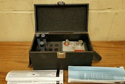 Victoreen Dosimeter Charger with Case and Instructions.