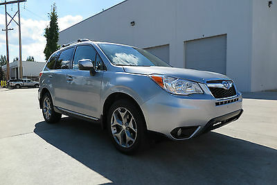 2015 Subaru Forester 2.5i Touring with Winter package, smart key system 2015 Subaru Forester 2.5i Touring with Keyless entry and start, 24k miles. NEW!
