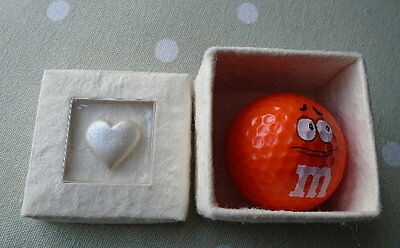 Novelty M&M Orange Golf Ball in white gift box decorated with a Heart