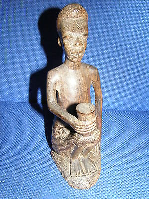 Vintage Carved Dark Wood African Tribal Man With Tribal Marks To Face & Beaker