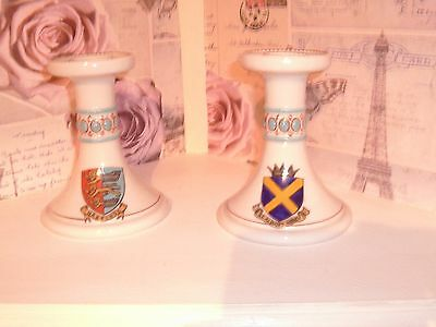 Two Goss crested  china candle sticks Hastings and St Albans Abbey