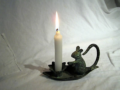 A Vintage Iron Chamberstick Candle Holder With Squirrel Decor