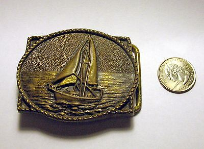 Vintage USA made 1978 BTS solid brass embossed sailboat scene belt buckle
