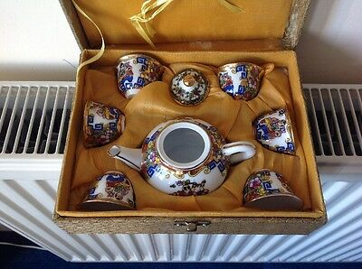 Chinese Tea Set Including Teapot And Six Cups