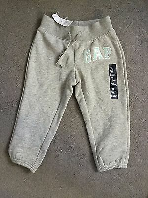 "GAP - GREY JOGGERS WITH AQUA GREEN SEQUIN ""GAP"" ON RIGHT LEG - AGE 4-5y - BNWT"