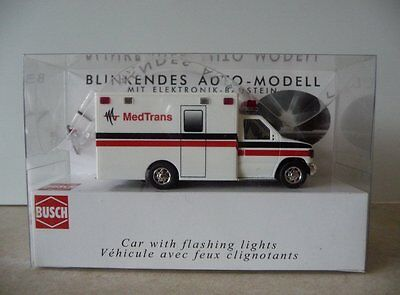 Busch Med Trans Ambulance, with flashing lights. Mint in original packing.