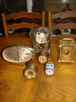 Job lot of clock movements x 6 for parts restore some working