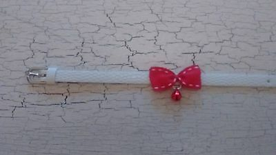 hand crafted white kitten collar with red bow