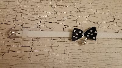hand crafted white kitten collar with black spotty bow