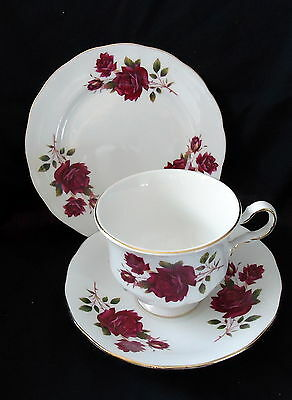 Queen Anne Trio White With Gold Trim with Dark Red Roses.