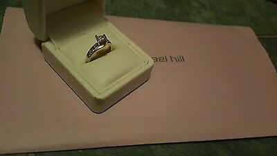 18 ct gold  1 ct diamond micheal hill engagement ring