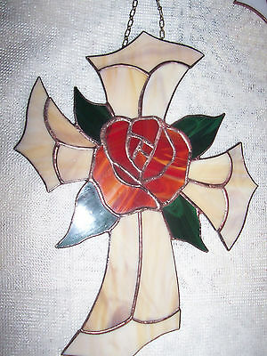 Stained glass cross with roses.