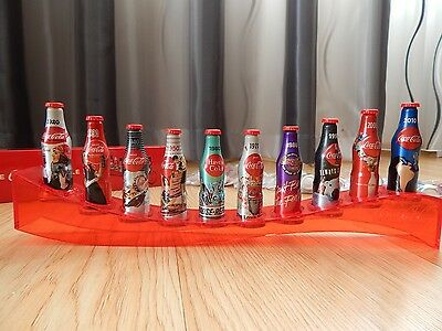 100 years of the Coca Cola bottle ( 10 mini aluminium bottles with stand ) LAST!