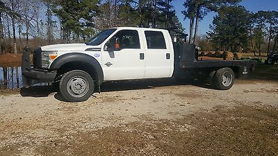 2011 Ford F-550  2011 F-550 6.7 Crew Cab 4x4 Flatbed Gin Pole Bed with 18k hydraulic PTO Winch