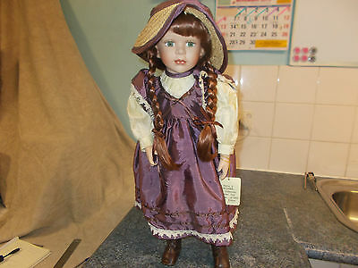 "Lucinda 22"" Bisque Porcelain Limited Edition Doll."