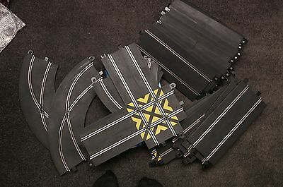 Job lot of Scalextric track with controllers and power supplies