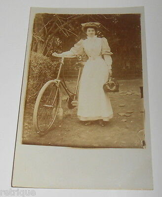 Early RP Postcard, Young Woman With Bike Holding Bag. Real Photograph.