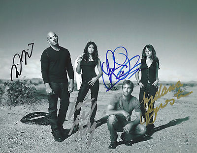 Fast and Furious Cast Signed By 4. Autographed 8x10 Photo With COA. Paul Walker