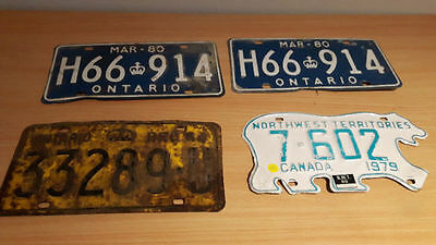 Lot of four license plates, 3 Ontario and 1 Northwest Territories polar bear