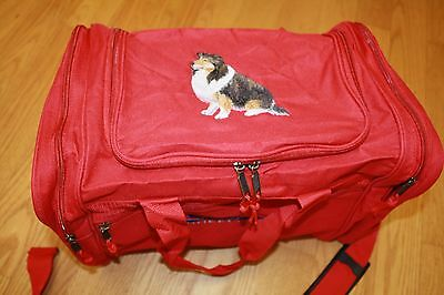 Sheltie, Shetland Sheepdog Embroidered On a Red Duffle Bag