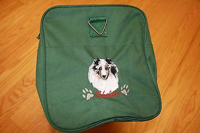 Sheltie, Shetland Sheepdog Embroidered On a Green Duffle Bag