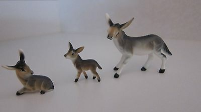 Donkey and baby statuettes
