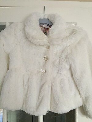 girls cream faux fur jacket age 6-7 years