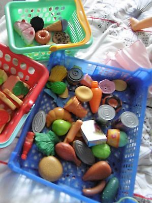 large amount of play food and 2  shopping baskets