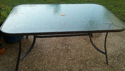 Outdoor Glass Top Table Seats 6.