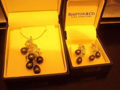 Sterling Silver necklace and earrings set with black pearls and green peridot