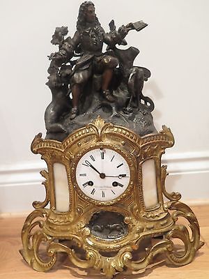 Beautiful French mid 19th century Gilded Bras and Bronze figural charming clock