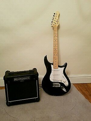 electric guitar and amplifier with tuner