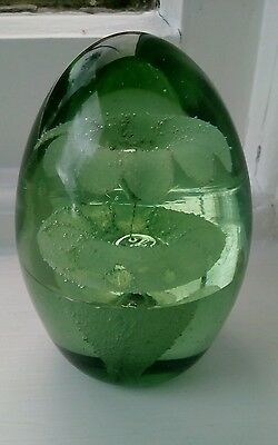 Antique green dump glass paperweight