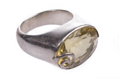 Silver ring with yellow stone