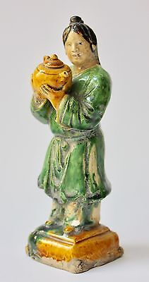 Chinese Sancai-glazed Pottery Figure of Attendant with Teapot, late Ming Dynasty