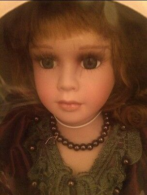 Porcelain doll new in box