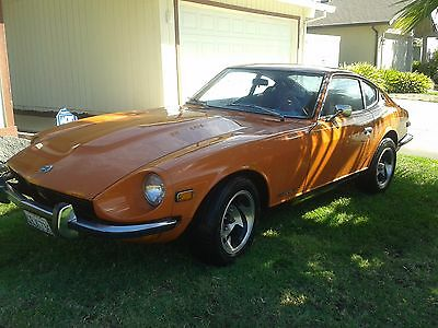 1973 Datsun 240 Z burn't orange w/ black interior