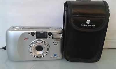 Konica Minolta Zoom 60 Compact 35mm Film Camera with 35-60mm lens and case.